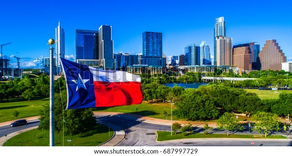 ATX City Skyline Texas Flag patriotic National Pride Displays the Lone Star State with a Colorful Austin Texas Skyline Cityscape Capital Cities Background on a Nice Sunny Summer Blue Sky Day