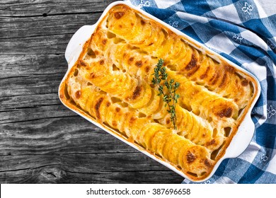 Au Gratin Dauphinois, Potatoes baked in a baking dish with butter and cream, authentic recipe, top view, close-up