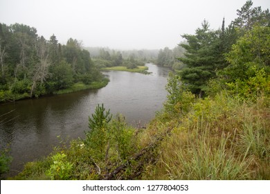 Au Sable River. Fog in a river valley of the famous Au Sable River in the Lower Peninsula of Michigan. The river is the centerpiece of the Huron National Forest.
