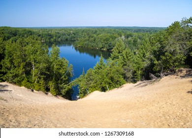Au Sable River Wilderness Overlook. View of the Huron National Forest wilderness with the famous Au Sable River in the lush green forests of Michigan.
