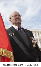 Aubagne, France. May 11, 2012. Portrait of a veteran of the French foreign legion in a jacket with military medals with the banner of veterans during the annual meeting of veterans.