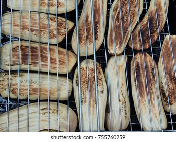 aubergines on a grill grill close-up, outdoors