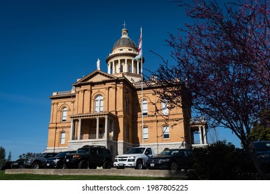 AUBURN, CA, U.S.A. - APRIL 2, 2021: Nearby view with redbud of the Placer County Historic Superior Court building located in the foothills of the Sierra Nevada mountains in Northern California.