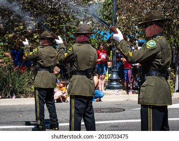 AUBURN, CA, U.;S.A. - JULY 4, 2021:  Photo of three Placer County Honor Guard members firing a salute to fallen people in uniform during a small town July 4 parade.