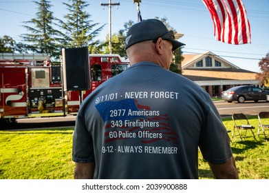 AUBURN, CA, U.S.A. - SEPT. 11, 2021: Capt. Darrell Steinhauer of Tahoe Station shows the back of his gray t-shirt at a ceremony remembering the 20th anniversary of the 911 Sept 11 terrorist attacks.
