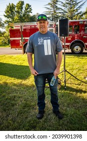 AUBURN, CA, U.S.A. - SEPT. 11, 2021: Capt. Darrell Steinhauer of Tahoe Station wears a Remember 911 t-shirt as he attends a ceremony for the 20th anniversary of the terrorist attacks in New York.