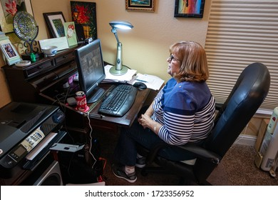 AUBURN, CA/U.S.A. - APRIL 19, 2020: Photo of De Calvert on her computer in a Zoom meeting with members of her choir.  The group holds weekly rehearsals to keep the choir going because of COVID 19.
