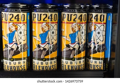 AUBURN, CA/U.S.A. - DECEMBER 20, 2018: A close-up photo of four cans of the Auburn Alehouse Imperial India Pale Ale (IPA) with a controversial label of a woman with a sailor hat sitting on a bomb.