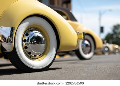 Auburn, Indiana, USA - September 9, 2018 The Auburn Cord Duesenberg Festival, close up or rear wheels of A Cord classic car parked on the streets of downtown Auburn Indiana after the parade