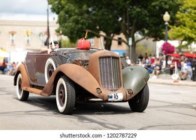 Auburn, Indiana, USA - September 9, 2018 The Auburn Cord Duesenberg Festival, An Auburn classic car unrestored driving down the street during the parade