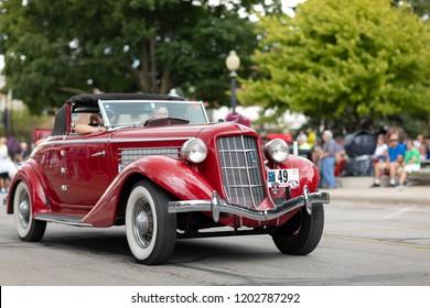 Auburn, Indiana, USA - September 9, 2018 The Auburn Cord Duesenberg Festival, An Auburn classic car driving down the street during the parade