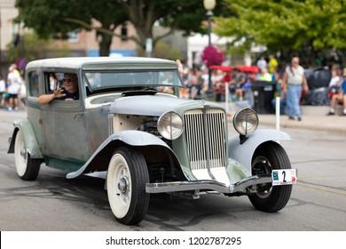 Auburn, Indiana, USA - September 9, 2018 The Auburn Cord Duesenberg Festival, An Auburn unrestored  classic car driving down the street during the parade
