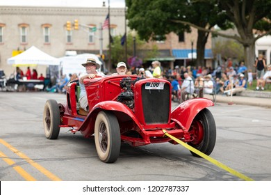 Auburn, Indiana, USA - September 9, 2018 The Auburn Cord Duesenberg Festival, An Auburn classic car being towed down the street during the parade