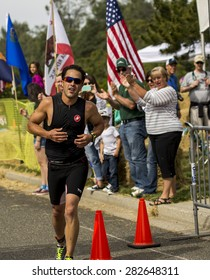 Auburn - May 17: A runner who made to the finish line as the crowd cheer's him on May 17, 2015 Auburn, California