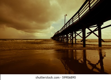 Auburn storm clouds role in over a quiet fishing pier on Myrtle Beach