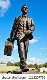 Auburn, USA - October 20, 2018 - Robert Wiley statue next to the Auburn Cord Duesenberg Automobile Museum in Auburn, Indiana