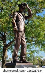 Auburn, USA - October 20, 2018 - Alan Leamy statue next to the Auburn Cord Duesenberg Automobile Museum in Auburn, Indiana