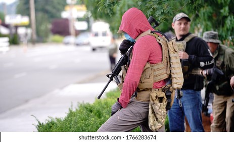 Auburn, WA/USA - June 2: Street View armed men appear with automatic weapons as protesters gather at City Hall to March for George Floyd Auburn on June 2, 2020
