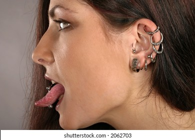 auburn-haired girl, woman with ear-rings and studs