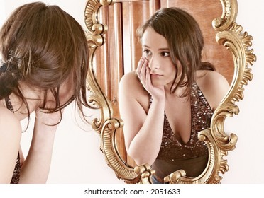 auburn-haired girl, young woman in front of a mirror