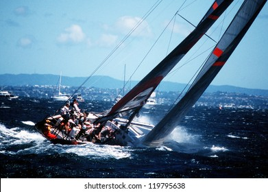 AUC - MARCH 1:Team Alinghi sails it yacht during the Americas cup of 2003 on March 01 2003 in Auckland New Zealand.It was contested between Team NZ and the winner of the 2003 Louis Vuitton Cup Alinghi. Best for smaller scale.