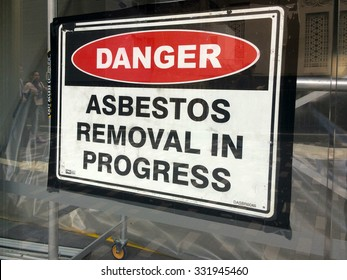 AUCKLAND - AUG 01 2015:Sign reads: Danger - Asbestos removal in progress.Inhalation of asbestos fibers can cause serious and fatal illnesses including lung cancer, mesothelioma and asbestosis.