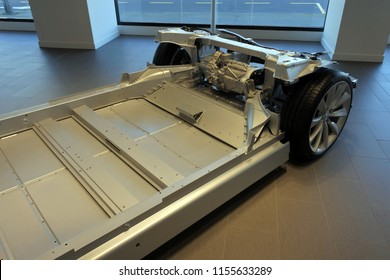 AUCKLAND - AUG 12 2018:Above view of Tesla plug-in electric car chassis and battery. Since 2003 Tesla is a world's leader to use  sustainable energy especially with it's innovative electric cars.