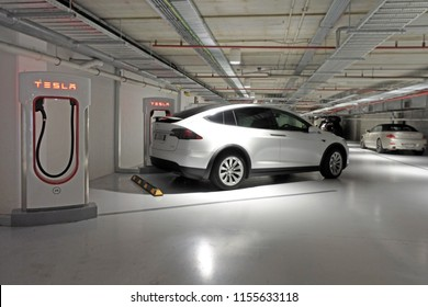 AUCKLAND - AUG 12 2018:Tesla plug-in electric car Model X been charged by a Supercharger network in Supercharger station.Model X ranked in 2016 seventh among the world's best-selling plug-in cars.
