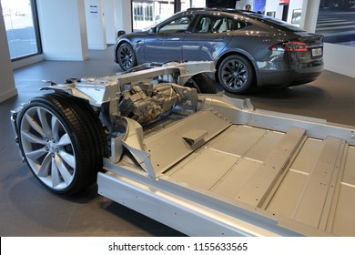 AUCKLAND - AUG 12 2018:Tesla plug-in electric car chassis in front of Tesla Model X a luxury, crossover utility vehicle (CUV). in 2016 seventh among the world's best-selling plug-in cars.