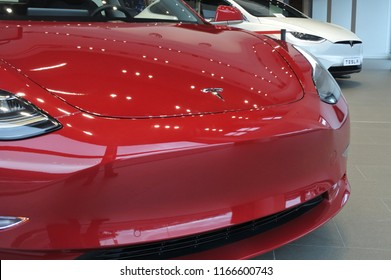 AUCKLAND - AUG 28 2018:The insignia of Tesla on the front bonnet of the plug-in electric car Model 3, a mid-size / compact executive luxury four-door sedan manufactured and sold by Tesla, Inc.