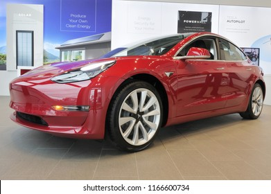 AUCKLAND - AUG 28 2018:The plug-in electric car Model 3, a mid-size / compact executive luxury four-door sedan manufactured and sold by Tesla, Inc.