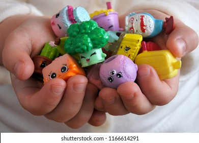 AUCKLAND - AUG 28 2018:Young girl holding Shopkins a range of tiny collectable toys manufactured by Moose Toys.Based on grocery store items each plastic figure has a recognizable face and unique name.
