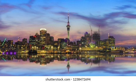 Auckland city skyline at twilight and reflection on sea