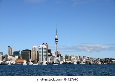 Auckland City and Skytower with yachts sailing past on a clear sunny day.  Viewed from across the Waitemata Harbour, Auckland, New Zealand