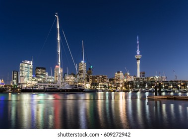 Auckland cityscape at night from the Viaduct Harbor marina with the business district skyline in the background in New Zealand largest city