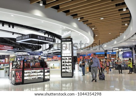 AUCKLAND - DEC 05 2017: Passengers passing through the new Auckland airport International departure duty free area.More then 10 million passengers use Auckland international terminal each year