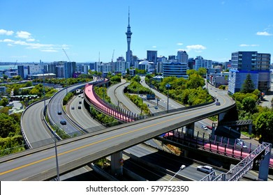 AUCKLAND - FEB 11 2017: Urban aerial landscape view of traffic on Auckland city motorway. Auckland is the most populous urban area in New Zealand.