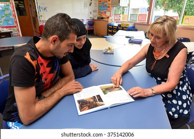 AUCKLAND - FEB 21 2016:Auckland University of Technology teacher teaches Syrian refugee English at Mangere Refugee Resettlement Centre.New Zealand annual intake is 750 refugee fleeing war in Syria.