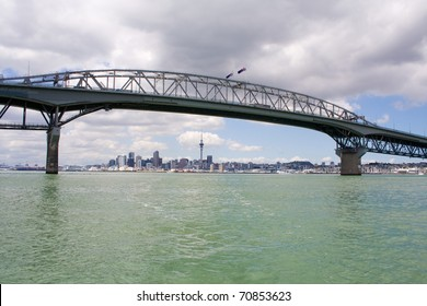 Auckland Harbour Bridge with Auckland City and Sky tower in the background, New Zealand