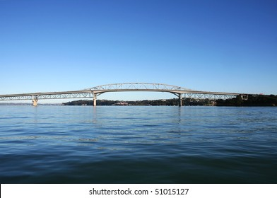 Auckland Harbour Bridge viewed from the ocean on a bright sunny morning