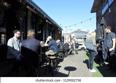 AUCKLAND - JULY 06 2018:People dining at Ponsonby Central a popular outdoor center of cafes, bars and market with gourmet food vendors in Auckland, New Zealand.