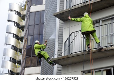 AUCKLAND - JULY 21 2016:Window cleaners works on high rise building.Window cleaning is considered one of the most dangerous job in the world.Several window cleaners die each year and many are injured