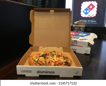 AUCKLAND - JULY 30 2018: Open Domino's Pizza takaway box on a table. Founded in 1960, Domino's is the second-largest franchised pizza chain in the United States after Pizza Hut in 81 countries.