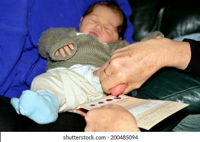 AUCKLAND - JUNE 09 2014:Midwife takes blood sample from a newborn during metabolic screening test.Newborn screening samples are collected from the infant between 24 hours and 7 days after birth.