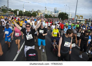 AUCKLAND- MARCH 18: Participants of Auckland Round the Bays, one of the world's largest fun-runs with an estimated 70,000 entrants, on March 18, 2012 in Auckland, New Zealand.