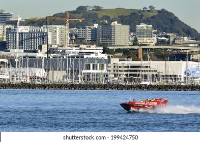 AUCKLAND - MAY 28 2014:Auckland Jet boat adventure tours in Waitemata Harbour.The speed boat, Ruby Red Lips, top Speed is 42 knots / 85 - 90 Kms with the capacity of 23 passengers.
