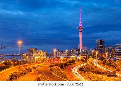 Auckland Motorway and Auckland Skyline, illuminated at twilight and with car headlight trails.