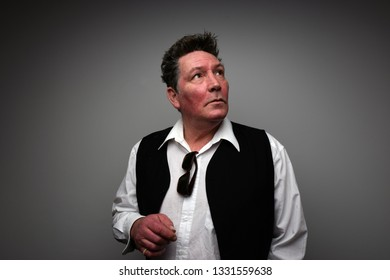 Auckland, New Zealand, 11/16/14, Graham Brazier, Front Man for New Zealand Band Hello Sailor, pauses for thought