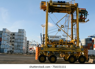 AUCKLAND, NEW ZEALAND - 17th APRIL 2012: Straddle carrier and stack of containers at sea port.