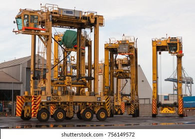 AUCKLAND, NEW ZEALAND - 2nd APRIL 2012: Four Noell straddle carriers and stack of containers at Auckland sea port.